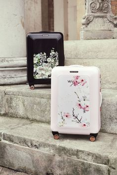 Pack your precious wedding pieces in style with Ted's floral luggage sets.
