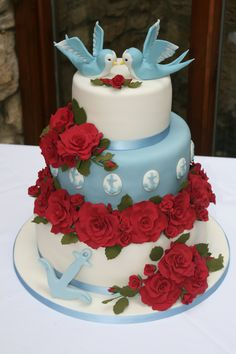 Rockabilly wedding cake with hand made roses and birds