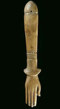 Clapper - Egyptian music instrument, shaped as hand on papyrus stem.New Kingdom c.a. 1550-1069 B.C.).Some Egyptian ivory sets (c.a. 2000 B.C.) are shaped like arms and hands, implying that clappers began as extensions of natural body sounds like hand clapping.