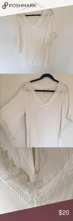 White, sheer dress. Lace detailing. This dress is on the shorter side and it's sheer as you can see from the hanger. Super cute summer dress, flowy. Size L but fits like a M. No stains. The lace has frayed a little but not much as you can see from the photos. socialite Dresses Long Sleeve