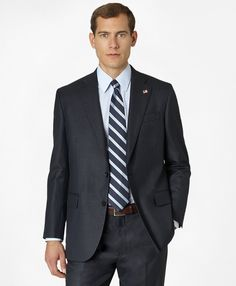 "<a href=""#pdplearnmore"" class=""lm"">The Madison Fit</a><br> Two-button suit, made from Saxxon wool, woven in Italy exclusively for Brooks Brothers. The original Madison Fit is favored for its relaxed fit, natural shoulders and easy-fitting trousers. Deep, hand-sewn upper armholes. Side vents. Half-canvas construction. Plain-front trousers. Dry clean only. Made in the USA. As a symbol of our dedication to American manufacturing, your Madison Fit suit arrives with an American Flag pin fastened…"
