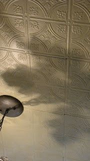 Kitchen ceiling - painted & glazed Armstrong paper tiles.