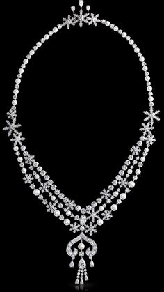 Faberge Zhivago necklace. This piece is set in 18 carat white gold and features 41 round pearls and 468 diamonds totalling 21.24 carats. The pear-shaped F VS2 diamond is of 1.13 carats and the white oval F VVS1 diamond is 0.92 carats.