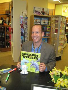 Chris Barton, pictured here at his signing table at Barnes & Noble, gave a wonderful talk on how important libraries and librarians have been to his writing. I am certain that if my sons were still young, I would know the text of Shark vs. Train by heart. And, one of them might have learned to read on it. Another cool fact about Chris is that he's working on a PB biography of JR Lynch.
