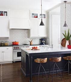 Black Kitchen island & glass front shelves above cabinets