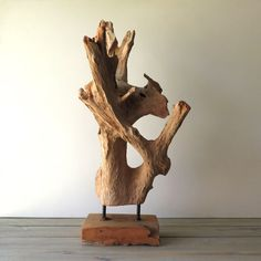 """Striking driftwood sculpture will look stunning in any room or decor! Rustic to Modern, this sculpture would display nicely on any table or credenza. The dimension of the base is 9 1/2"""" W x 6 1/4"""" D x"""