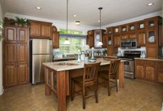 Check out this beautiful kitchen!  Belmont RB545A - Rockbridge Modular Home A great space, great island, great cabinet color, check it out on our site!