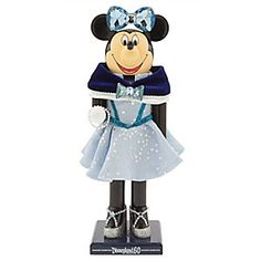 Minnie Mouse Nutcracker - Limited Release - Disneyland Diamond Celebration   Disney StoreMinnie Mouse Nutcracker - Limited Release - Disneyland Diamond Celebration - Minnie dresses up in style for the Disneyland Diamond Celebration. Created by Disney artist Alex Maher, this limited release nutcracker features Minnie wearing a crepe dress with velvet shawl and two faceted bows for added sparkle.