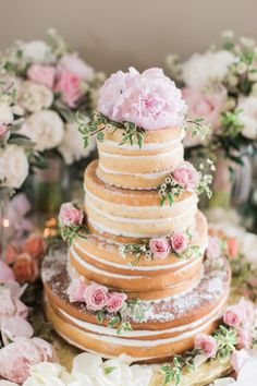 Naked Cake with Pink Flowers | photography by http://www.nicoledetonephotography.com/