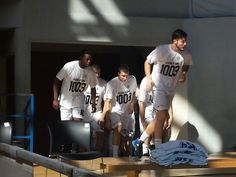 KK Partizan players enter the sports hall with special T-shirts to donate the floods victims (KK Partizan NIS - Metalac, 29.05.2014)