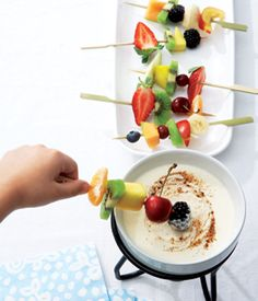 Love this fun after school snack idea that combines fruit kabobs with a honey ricotta fondue! All you need is one container of ricotta cheese, 1 cup of apple cider, 1 tsbp honey and a little cinnamon mixed together and warmed, and you've got a yummy dip for any combination of fruit kabobs you wish to make up. For more creative ideas for kids lunches LIKE US on Facebook @ www.facebook.com/...
