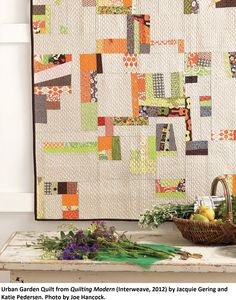 As the authors started arranging the scraps for this quilt, the fabric combinations began to look like   city garden plots. It does have that farm-fresh feel to me. This is the one I want for my living room... hint, hint @Katie Pedersen & Jacquie ;-)