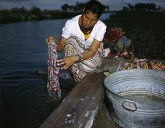 Seminole woman washing clothes beside an Everglades canal at the Big Cypress Seminole Indian Reservation. January 18, 1949