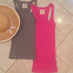 LOT 2 HOLLISTER SEXY STRETCH TANKS THINK SUMMER! TWO SEXY HOLLISTER STRETCH TANKS tops in excellent condition. one is fuchsia pink and the other is a neutral dove gray. Shows minor normal wear.   All of my items come from extremely clean non-smoking non-pet home and laundered only in eco-friendly detergent. Tops Tank Tops