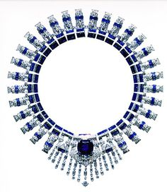 "One of the famous art deco sapphire and diamond necklaces was owned by Marjorie Merriweather Post.  Created by Cartier in 1936, with hundreds of square, round, baguette cut sapphires and diamonds– Mrs. Post simply called it ""The Blue Necklace.""  A large and perfectly blue cushion shape sapphire is set in the center of a diamond deco motif.  The necklace can be unclipped into two separate bracelets and the center sapphire can be made into a brooch."