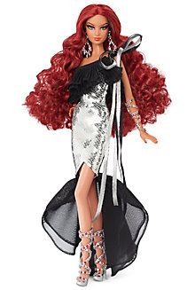 2014 ~ Renowned designer Stephen Burrows returns with his third fabulous Barbie® doll. Nisha™ wears a dress featuring a one-sleeve design and countless sparkling, silvery sequins.