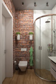 An exposed brick wallpaper has given this small bathroom a fantastic 'urban' quality.