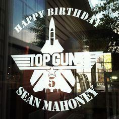 Vinyl sign décor on our Doorwall for my son's TOP GUN birthday party