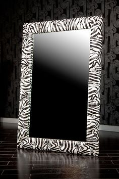 8017 ZEBRA MIRROR WITH SWAROVSKI CRYSTALS  Upholstered in a fabulous zebra patterned vinyl, this mirror is fun and glamorous. Swarovski crystals sit in tufts along the frame, sparkling brilliantly in the light and making this mirror a must-have piece.