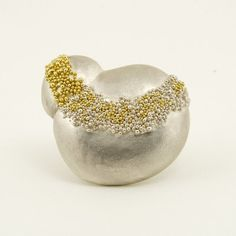 """Harold O'Connor at Patina Gallery. Pin, Sterling Silver base, Sterling Silver and 18K Yellow Gold Granulation, Cast from Moroccan Beach Pebbles, 1.5"""" wide, 1.25"""" tall"""