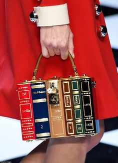An incredibly detailed bag is disguised as a book shelf and is secured with a lock decorat...