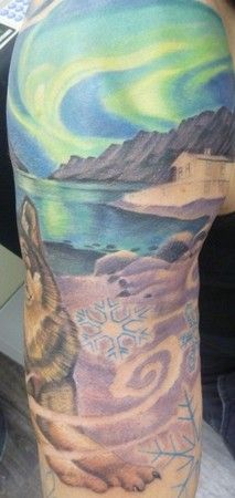 Amazing example of a Northern Lights tattoo.