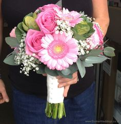 http://bookerweddings.co.uk - Pink Gerbera, Gpysophila, Pink Roses and Brassicas Brides Bouquet Side View.jpg