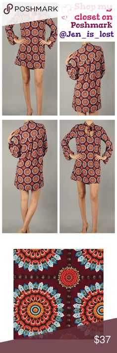 """Chic Drop Waist Woven Shirt Dress Large Chic Drop Waist Woven Shirt Dress with Ribbon Tie Scooped Neckline in Pretty Bohemian Sunshine Pattern.  Fabric: 100% Polyester. Large measures 20"""" across the chest and is 33"""" long and is 22"""" at the hip measurements taken laying flat.  TRADES  ✅ Reasonable Offers Are Considered.✅ Use the blue offer button. Dresses"""