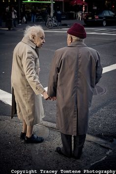 Short walk, long journey......An elderly couple hold hands while waiting to cross the street in New York City, NY.