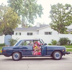 Flowerbombing: the act of filling someone's entire front seat with flowers. Love it! :)