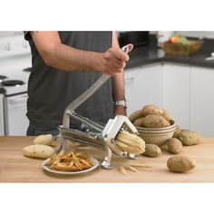 Use the Kitchener Deluxe French Fry Cutter to make fast-food fries at home. High-quality cutter has aluminum base with 2 blade grids for cutting either or size fries. Base can be mounted for extra stability. Cooking Gadgets, Cooking Tools, Cooking Recipes, Healthy Recipes, French Fry Cutter, Good Food, Yummy Food, Sandwiches, Le Chef