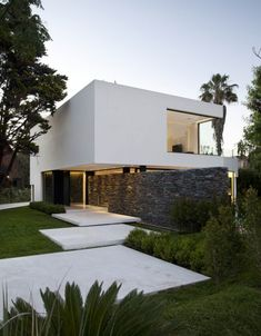 Carrara House by Andres Remy Arquitectos in Buenos Aires. Nice mix of materials as rustic stone contrasts with the white carrara marble featured inside the house. Architecture Design, Residential Architecture, Amazing Architecture, Contemporary Architecture, Installation Architecture, Landscape Architecture, Architecture Sketches, Building Architecture, Contemporary Design