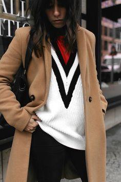 Nisi is wearing: Camel Coat, Céline Edge bag, skinny jeans, Jimmy Choo Tide sling-back pumps, V-neck knit