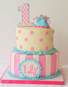 - First Birthday cake made to match the outfit of the party girl! Cake is buttercream with fondant decorations