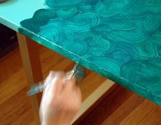Step-by-step DIY surface  faux malachite surface - same technique for faux wood.  From Little Green Notebok.