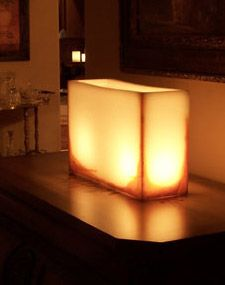 """Hollow Wax Candle Display Ivory with Rust Accent 15""""  x 12"""" Reusable   $70. With LED """"candle"""" inside. Might be good for outdoors of it all."""
