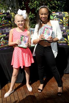 Dancers JoJo Siwa and Nia Sioux attend the GBK & Stop Attack Pre Kids Choice Gift Lounge at The Redbury Hotel on March 26, 2015 in Hollywood, California.