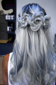 Silver to Grey ombre dip dye hair styled in 3 braided rose shaped buns half up.