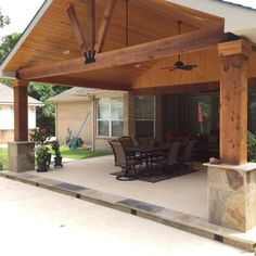 Gable roof patio cover attached to existing house with cedar beams and posts, flags or column base, and wood stained ceiling - Yelp