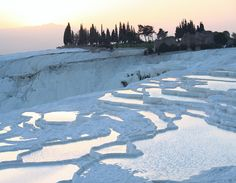 Natural Springs and Limestone Cliffs of Pamukkale in Turkey: the look of snow, but with green grass and heat!! Love to see this!