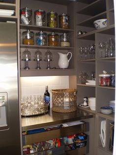 Suzie: The House That A-M Built - Fantastic pantry with taupe cabinets 7 shelves, stainless ...