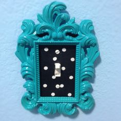 Fabric covered light switch (with added frame). So easy and so cute.