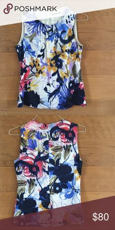 67b497fa67f5 Enjoy the flowers and good weather while wearing this beautiful sleeveless  blouse by Elie Tahari.🌻94% silk with 4% elastalane - back zip Elie Tahari  Tops