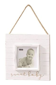"""Painted distressed wood frame with raised border around 4"""""""" x 4"""""""" opening features etched """"""""sweet baby"""""""" sentiment. Frame hangs with jute rope. Details Size: 8"""""""" x 8"""""""""""