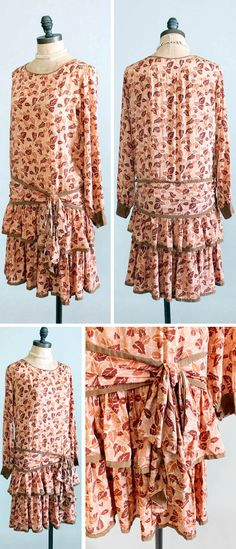 Day dress ca. 1920s. Lightweight silk with autumnal falling leaves print in shades of brown. Scoop neckline, long sleeves, straight bodice, and dropped waist. Hips wrapped with attached sash. Two tiers of ruffles make up skirt; underskirt has kick pleat. Slips over head with no side or back openings. Raleigh Vintage