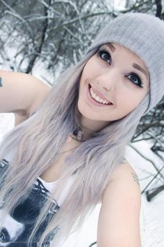 love the length and the hat :) <----said another pinner..im just wondering what the heck she is doing outside in a tank top, without a coat, when there is snow in the background! No wonder her hair is going white, she is frozen!