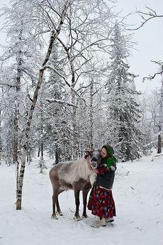 Nenets woman with reindeer