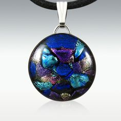 Original Style Dichroic Glass Memory Pendant - Round. Available in various shapes, styles and colors. This Original Style Round Memory Pendant is made from dichroic glass with a small amount of your loved one's cremains fused between layers of glass.