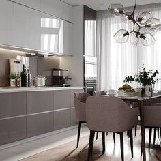 This two toned brilliant kitchen is gorgeous. Use this as inspiration for your home design & order your REHAU products today: www.rehau.com/us-en/furniture/surfaces/high-gloss/rauvisio-brilliant