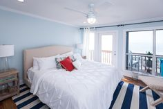 Take a before-and-after tour of this renovated beach house from HGTV's Beach Flip. See how contestants Alex and Martha added traditional, all-American style with classic beach accents and rustic finishes.